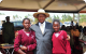 President Yoweri Museveni possing for a photography with Nebbi district PLE best