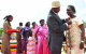 President Museveni decorating Minister of Health Christine Ondoa on behalf of he