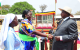 President Yoweri Museeni greeting Miss Oroch Christine who received her mother C