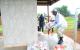 President Yoweri Museveni laying a wreath at the 1995 Atiak Massacre monument to