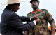 President Museveni  decrating Col Mukumbi with Luwero Triangle medal