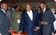 President Museveni and Rwanda President Kagame take their seats at a dinner orga