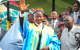 President Museveni waves to the crowd after being crowned as an Elder