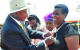 President Yoweri Museveni decorating Joy Mugyenyi with Nalubale medal
